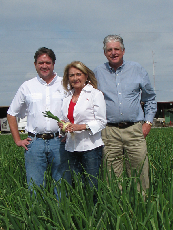 From left are pictured the co-owners of G&R Farms: Walt Dasher, Pam Dasher, and Robert Dasher.  Click to download high resolution image.