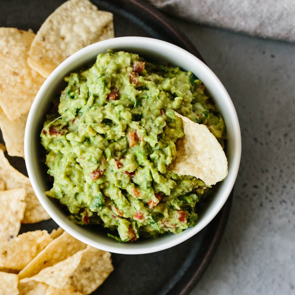 The Reliable Veteran: Guacamole - The perennial all-star that always shines in the biggest moments. Perhaps the Tom Brady of dips? Guacamole is a classic dip that may seem overdone, but people love it and many would argue a Super Bowl party wouldn't be complete without it. Guacamole always shows up ready for the game.Photo and recipe via: Downshiftology - Best Guacamole Ever