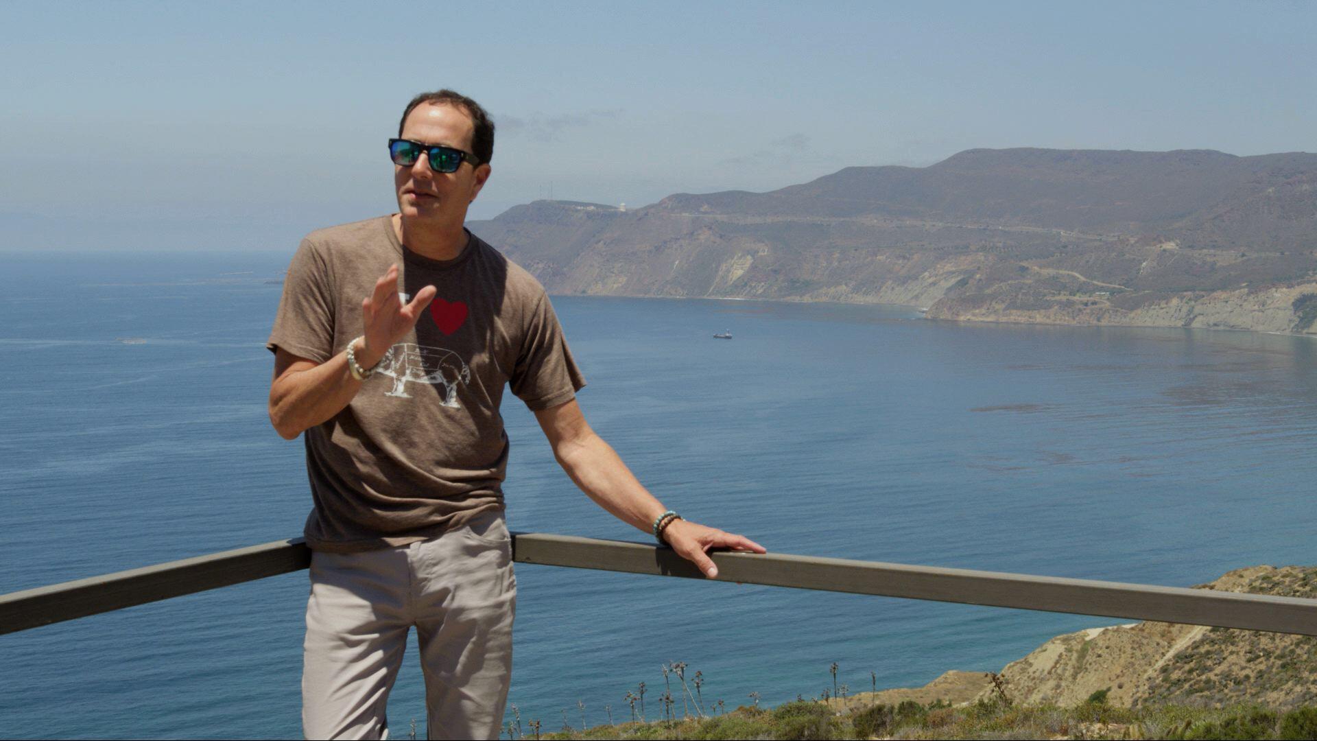Sam at   Cuatro Cuartos vineyard   overlooking   Ensenada