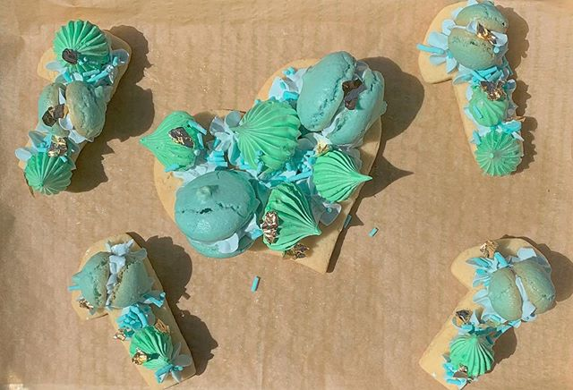 """The meringues from my previous post were for a special """"one month"""" post for my baby girl.  I also made some macarons and my own sprinkles.  This months color scheme: turquoise/sea foam/mint."""