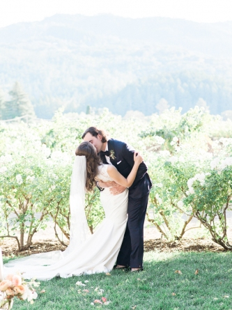 Carats & Cake Napa Wedding Bride & Groom Kiss in Vineyards.jpg