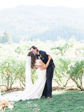 Carats & Cake Napa Wedding Bride & Groom Kiss in Vineyards.jpg