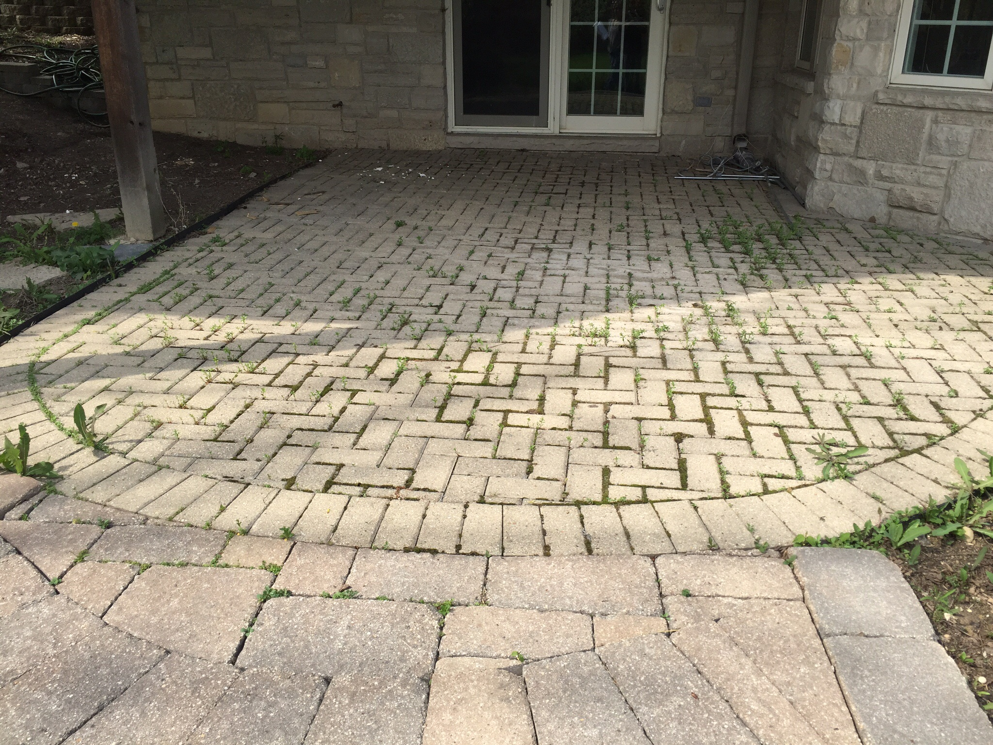 "Look at the stone on the house. The patio Hardscape area cheapens it. It's horrible and this is what people are paying for? I don't think one homeowner would want this ""quality work"" at their home."