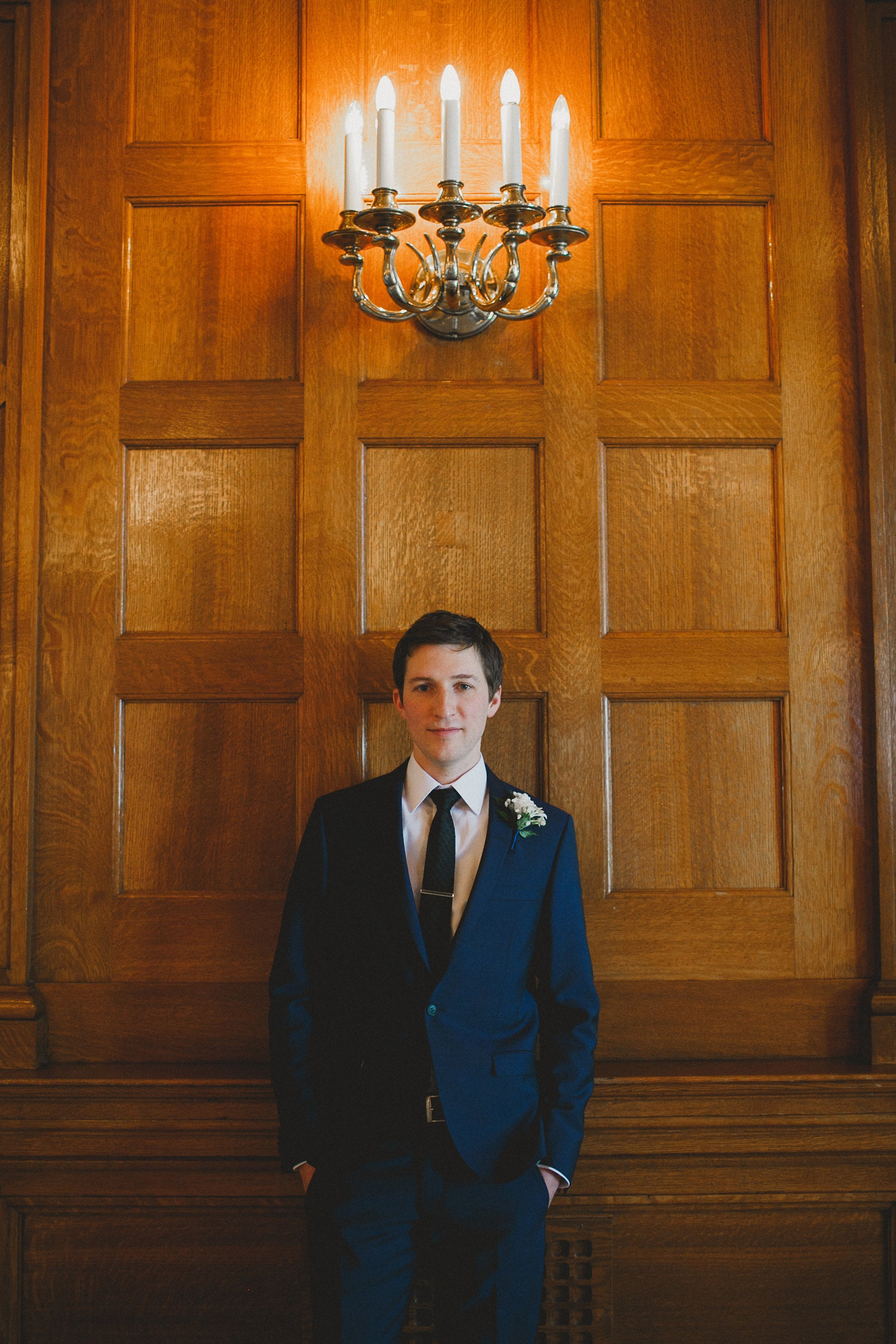 Winnipeg Winter Groom in Tiger of Sweden Suit at Fort Garry Hotel Winnipeg Manitoba