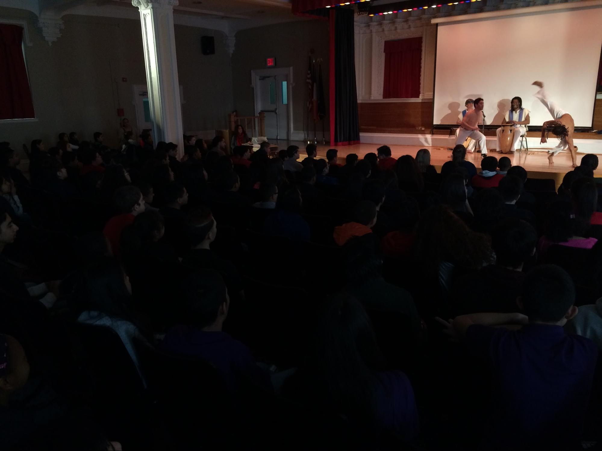 Capoeiristas astound their audience through dance, martial arts, and music.