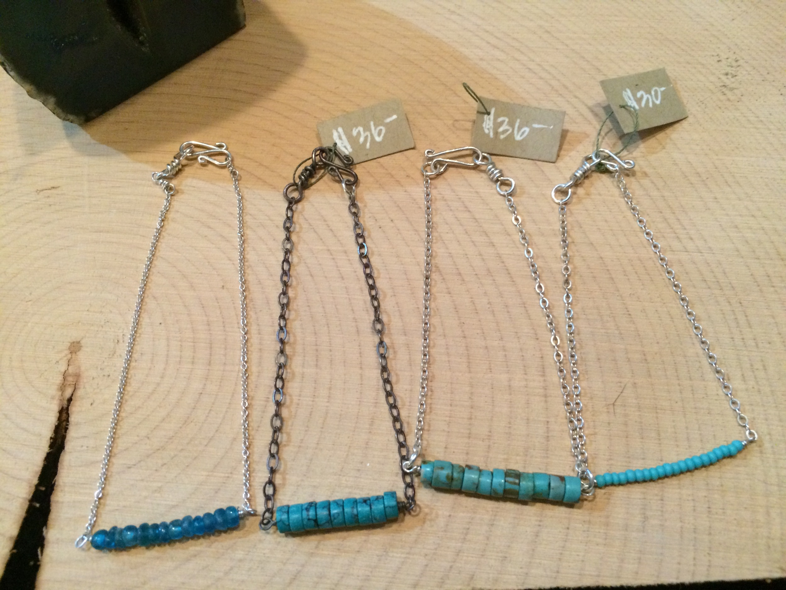 bracelets l to r: apatite + sterling: $36 || turquoise + oxidized sterling silver: $36 || turquoise + sterling silver: $36 || blue glass + sterling silver: $30