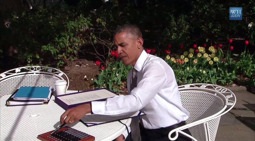 """President Obama signs a permanent Medicare """"doc fix"""" in the Rose Garden."""