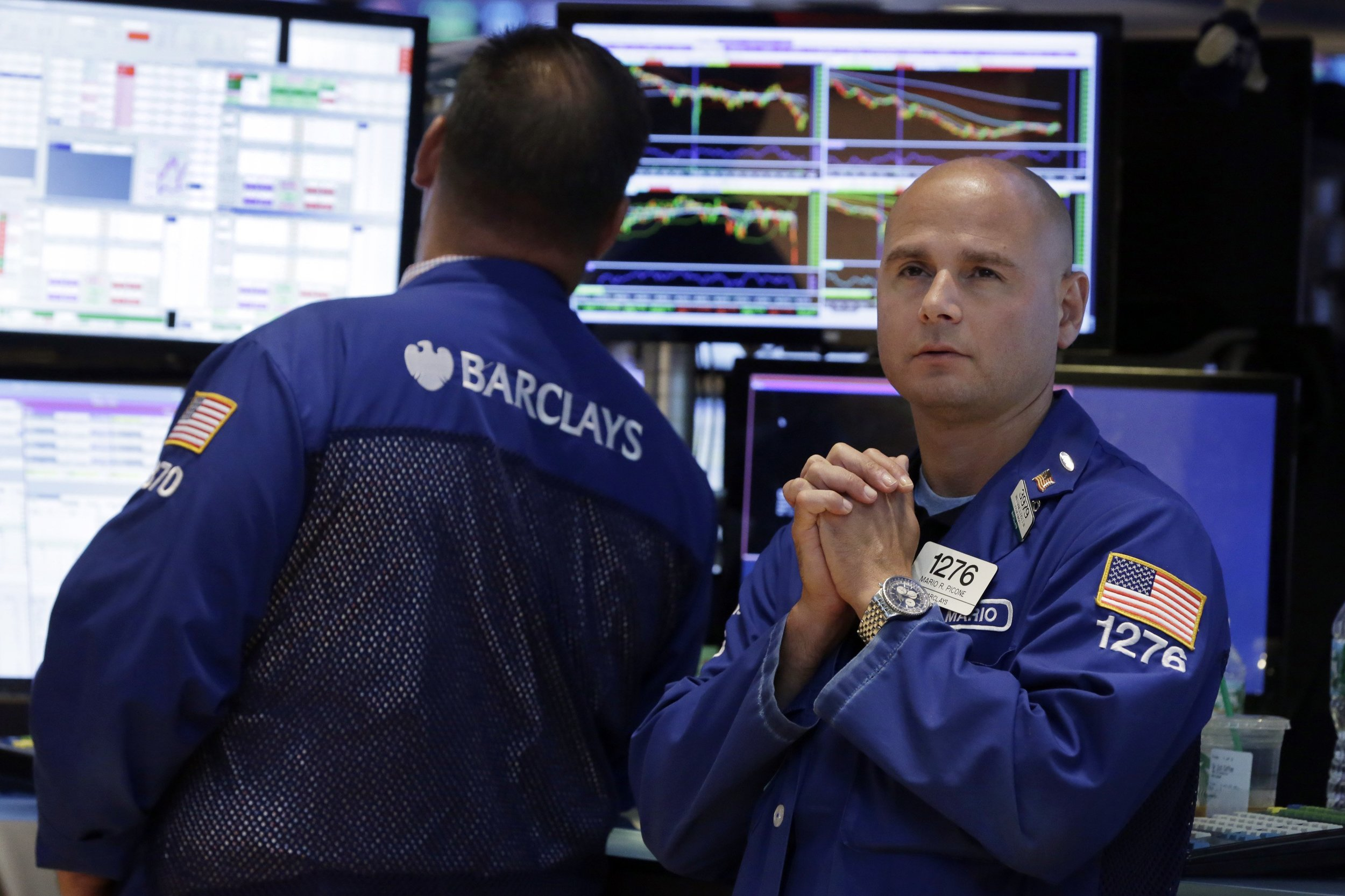 Specialist Mario Picone, right, watches the numbers as he works on the floor of the New York Stock Exchange, Friday, Aug. 21, 2015. The Dow Jones industrial average has plunged more than 530 points and is in a correction amid a global sell-off sparked by fears about China's slowing economy. Oil tumbled below $40 per barrel for the first time since the financial crisis. (AP Photo/Richard Drew)
