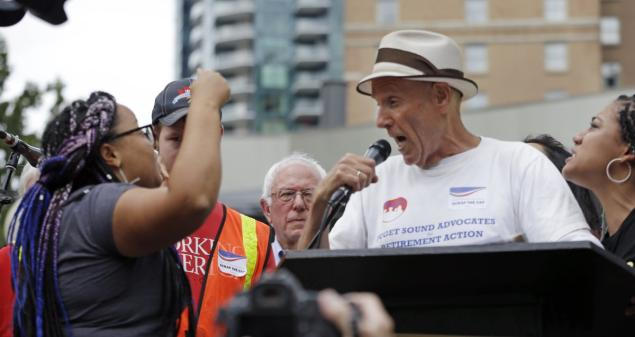 A Bernie Sanders supporter yells at members of the Black Lives Matter movement.