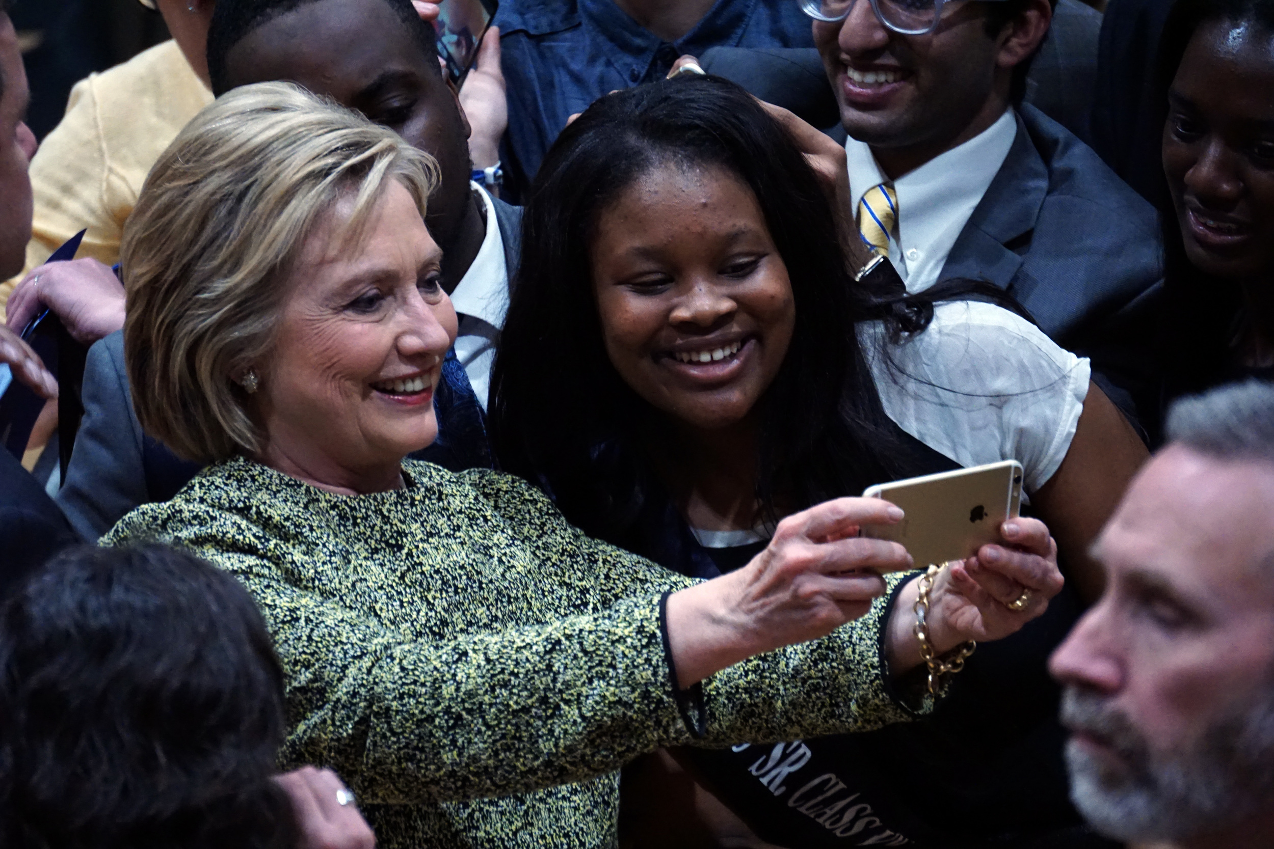 Hillary Clinton takes a selfie with a supporter at a campaign rally at Hillside High School in Durham, North Carolina. Photo by Nathania Johnson, Licensing: Creative Commons.