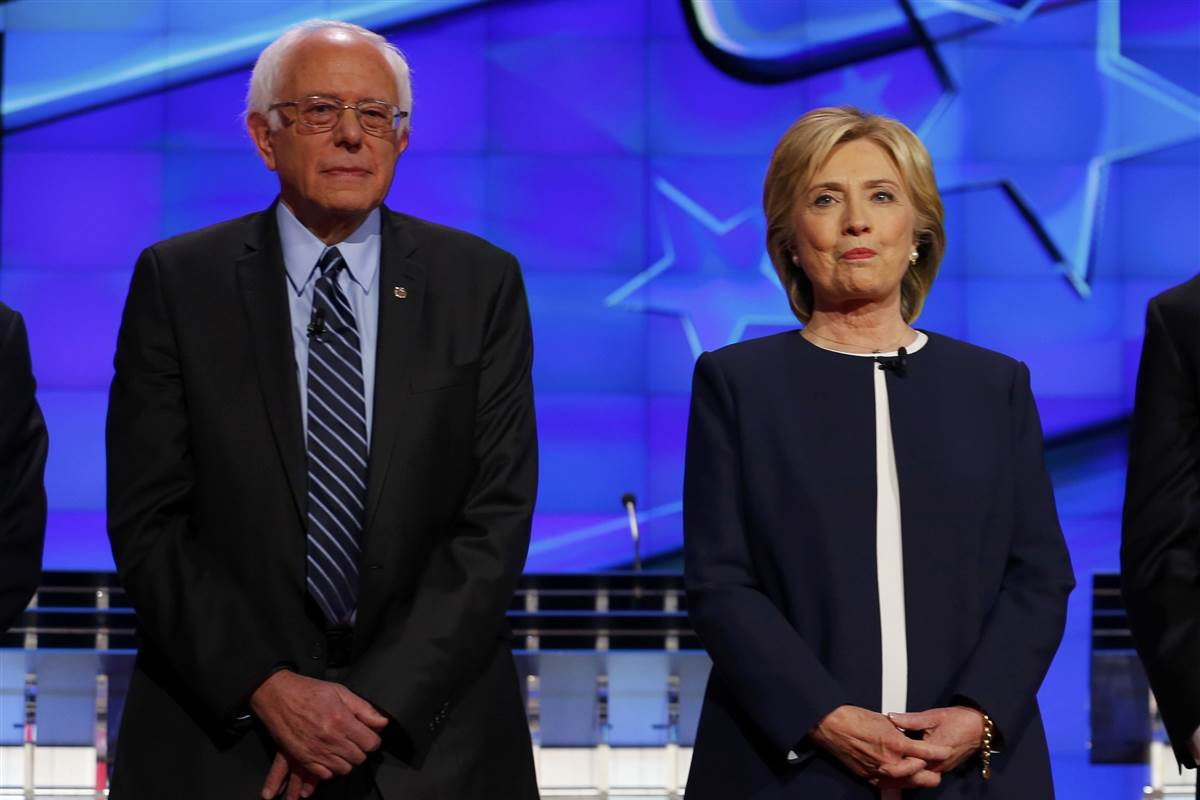 Bernie Sanders and Hillary Clinton before the November Democratic debate. Image from NBCNews.com.