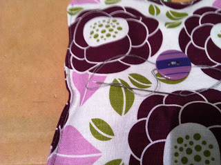 Finish by wrapping the thread around the button and looping it through itself twice