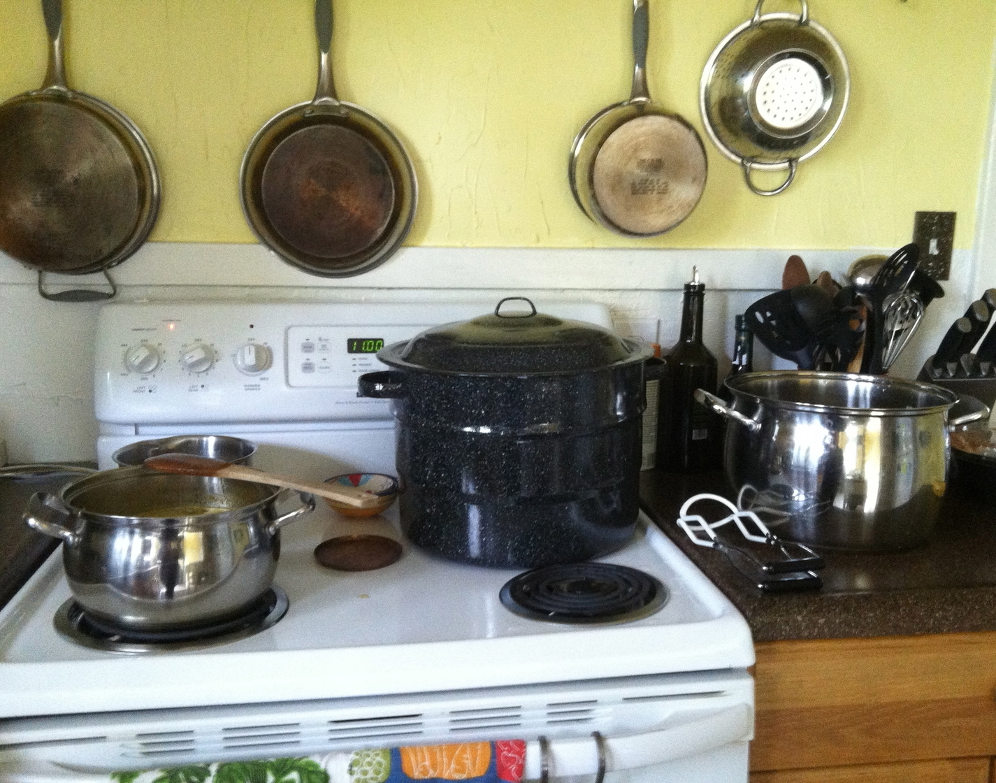 My home canning set-up: the recipe, water bath canner, jar lifter, and second pot for heating jars.