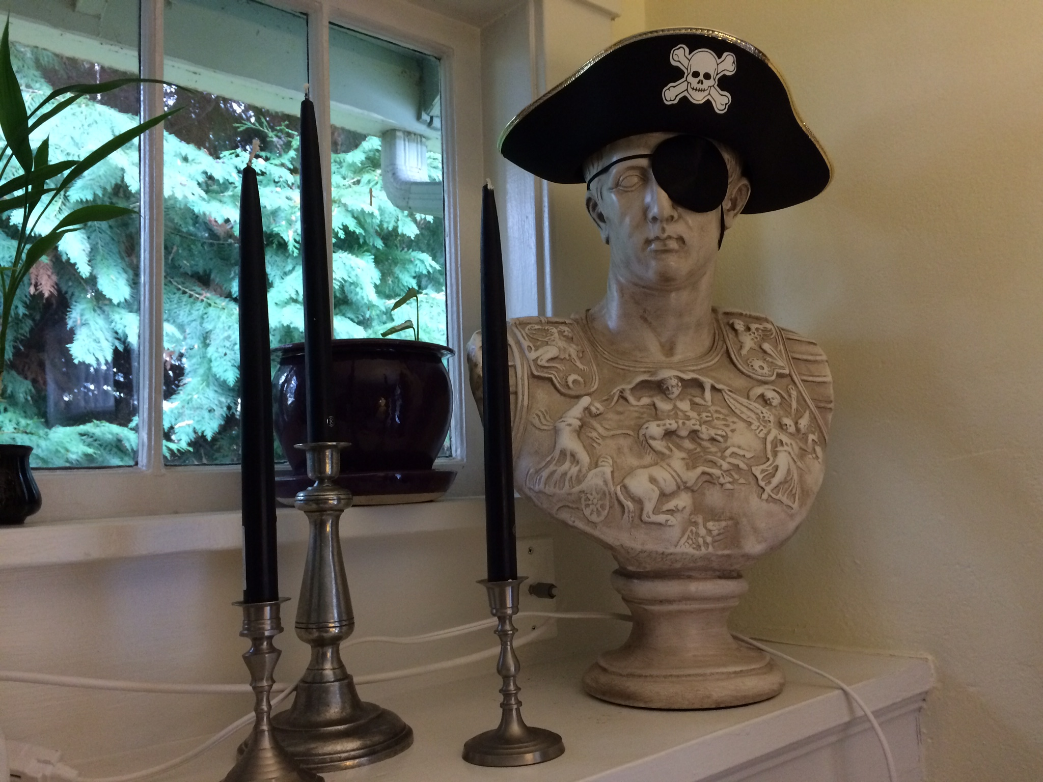 Purple taper candles are replaced by black as a companion to Jolly Roger Marc Antony