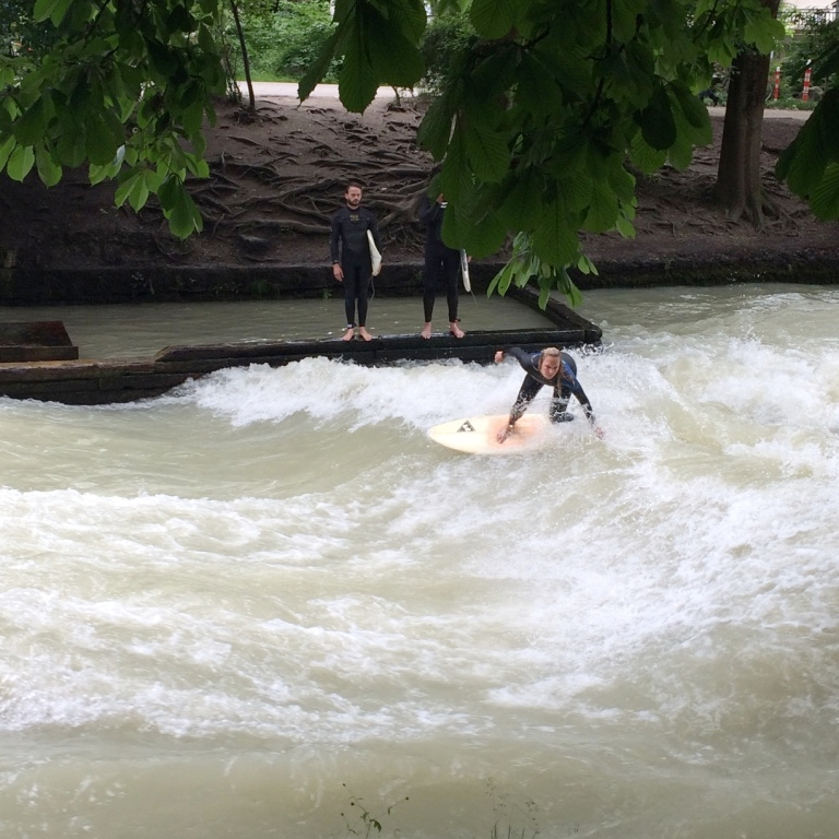 Rad babe surfing the Eisbach river in the English Garden