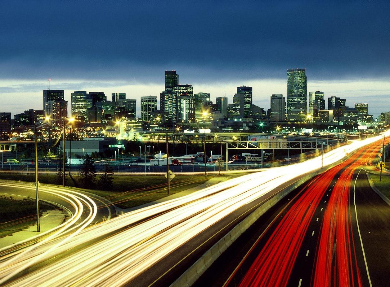 Car lights moving around city.jpg