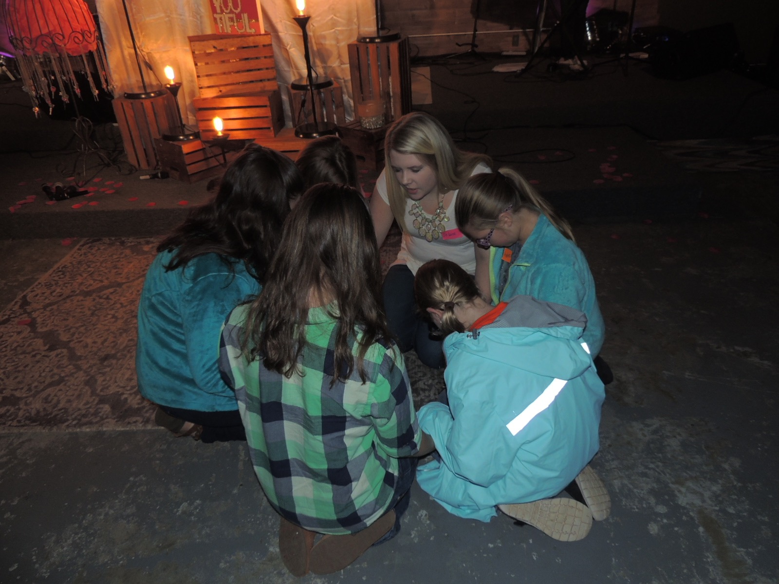 Youth leader praying over girls!