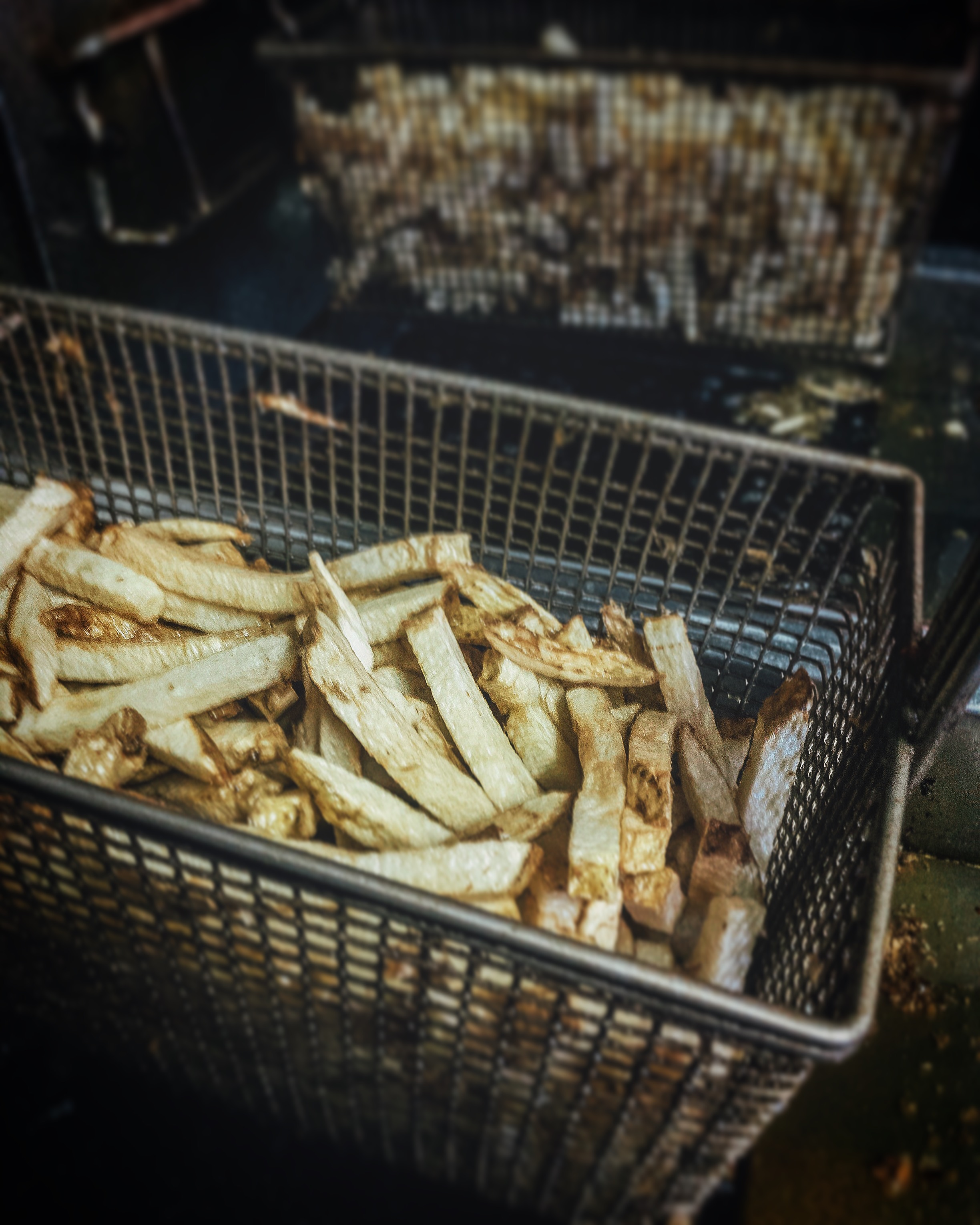 A basket of Blanched Fresh Cut Fries.