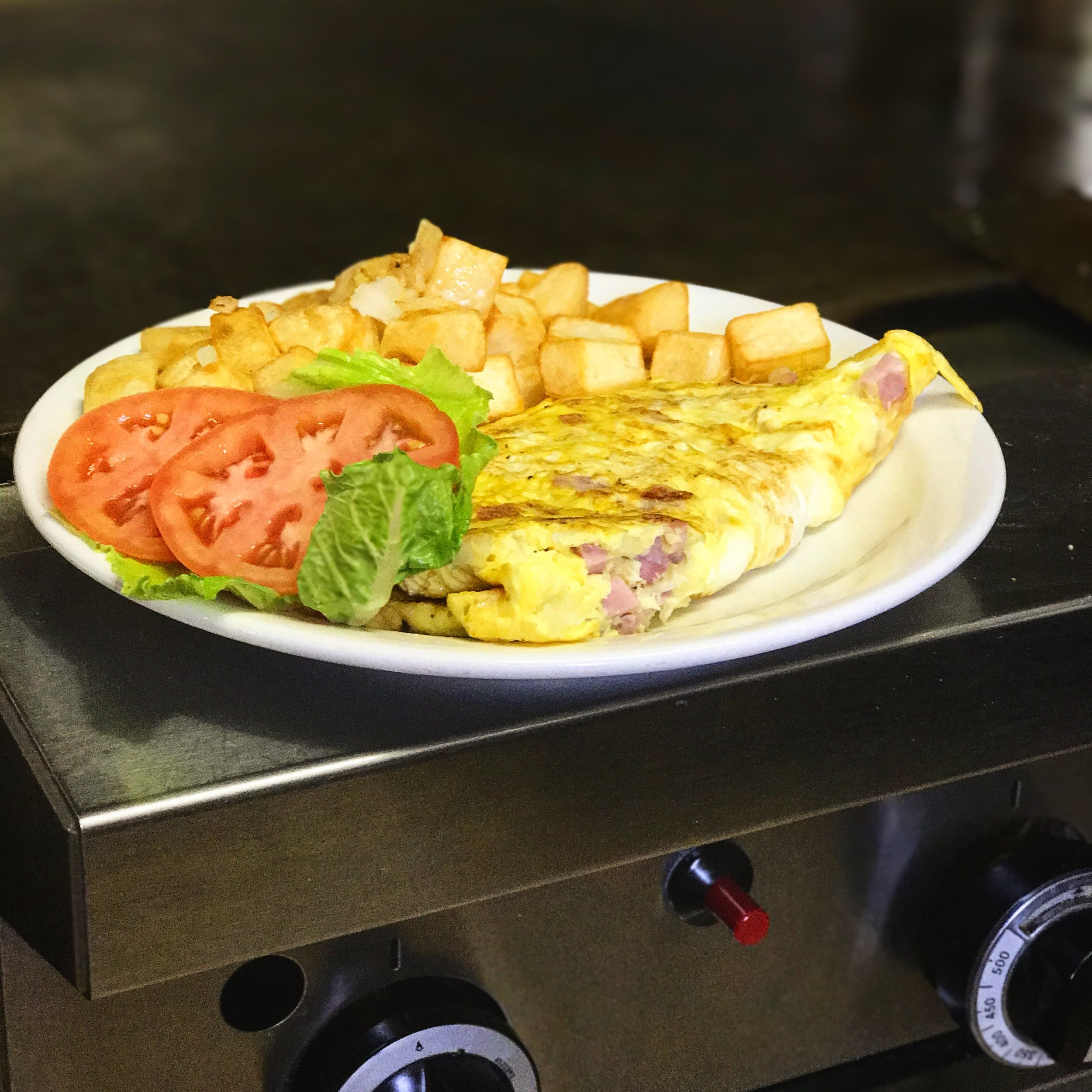 3 eggs, Onions, Ham, Home fries and Toast = Western Omelette