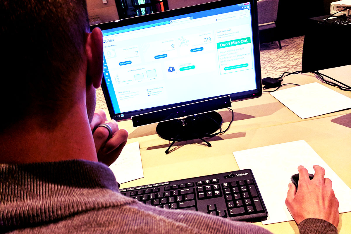 A user participates in a study I designed for our GazePoint eye tracker setup.