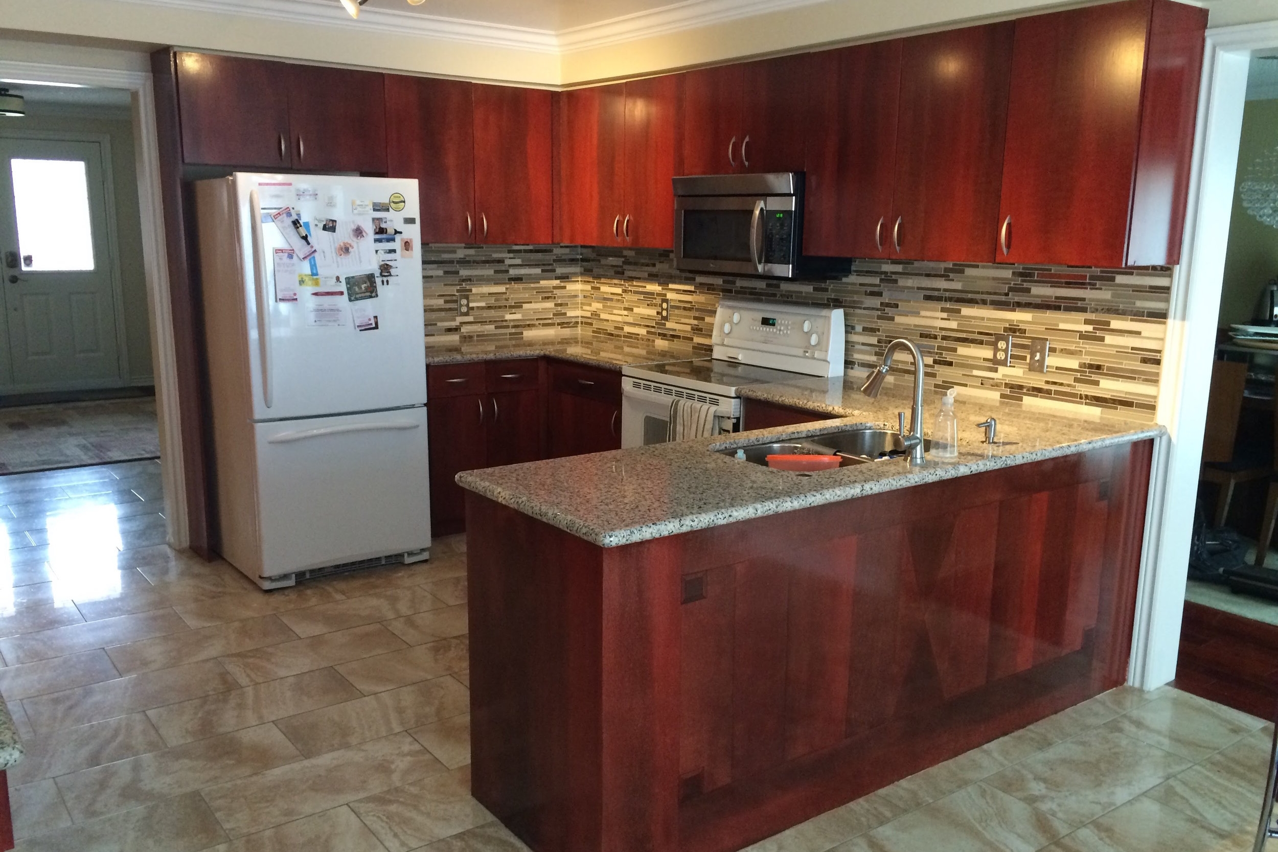 Cabinet Refinishing - You will be surprised by how much of a difference repainting your kitchen makes.  We paint cabinets on location with either oil or latex paint depending on your desired finish or product preference.