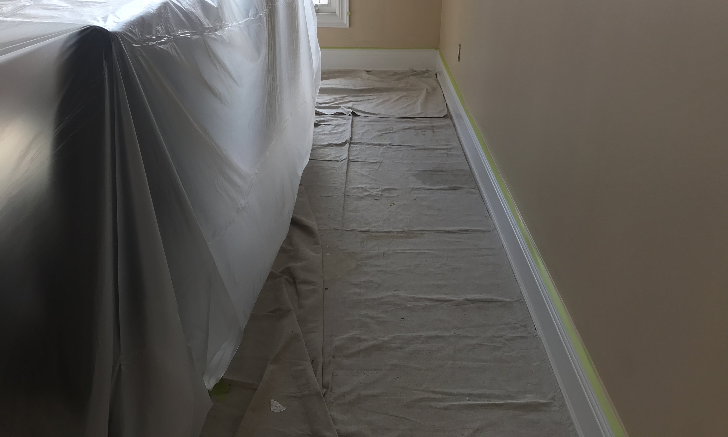 Drop Sheets For Floors - We cover floors with cloth drop sheets to protect from spills and roller overspray.