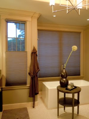 Warm colored LED and CFL sources are being seen more and more in California bathrooms and kitchens due to California's Title 24 requirements.