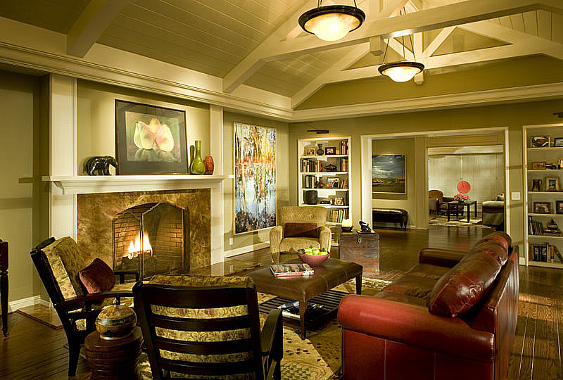Living room - A pair of alabaster pendants by Lightspann provides decorative and ambient light. Each uses four dimmable CFL's by Maxlite, with 400 watts/fixture, but consuming only 96 watts worth of power. Track lighting at the apex beam is fitted with LED MR16's bulbs by Philips/Color Kinetics-- accent light without harmful UV.