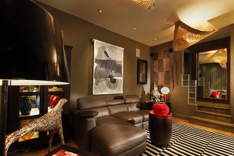 This media room uses layers of ambient, task, accent and decorative lighting to create a space where the people feel as important as the art.