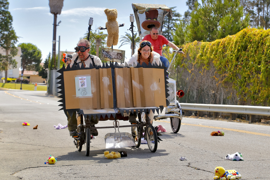 """Samuel Coniglio and Katherine Becvar, of Oakland, pilot their vehicle """"Wasted Spirits"""" through the Flying Monkey obstacle during the 2015 Obtanium Cup Contraptor's Road Rally held at Mare Island, Sunday, July 19, 2015, in Vallejo. (Steve Reczkowski/Daily Republic)"""
