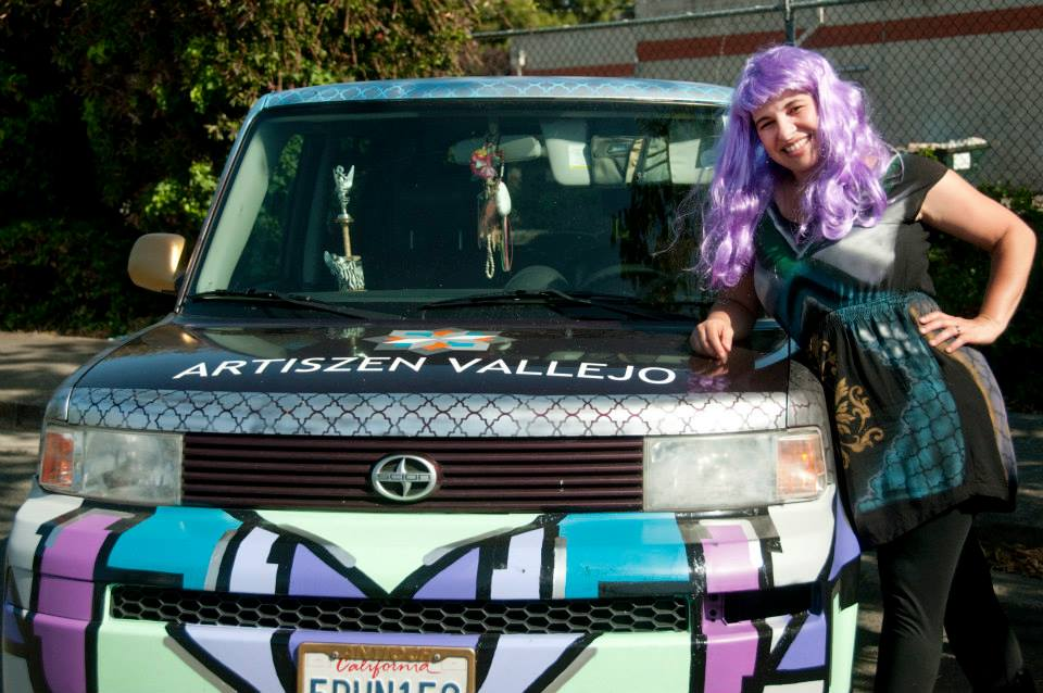 Dominique Guiterrez of ArtisZen adds an outfit to fit her newly painted art car!