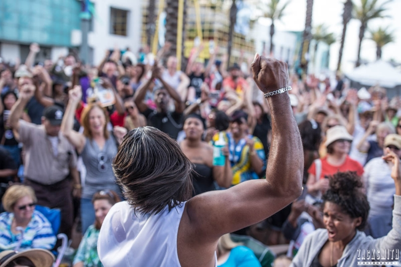 Big Chief Bo Dollis Jr. rallies the energetic crowd at the GE Capital Stage at the  2016 French Quarter Fest in New Orleans. ©Zack Smith