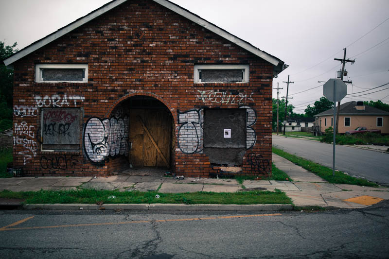 Zack Smith Photography New Orleans Graffiti bricks boarded up ruins