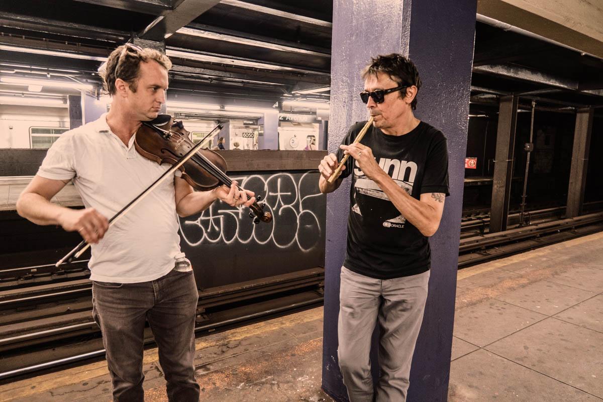 Zack Smith Photography New York City Pilette's Ghost Fiddler Wood wind Instrument Graffiti subway street musicians