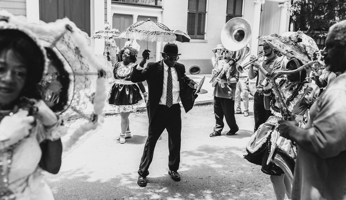 Treme Brass Band, Baby Dolls, Grand Marshall. Add sax, trumpet, drums and all those parts make the whole.