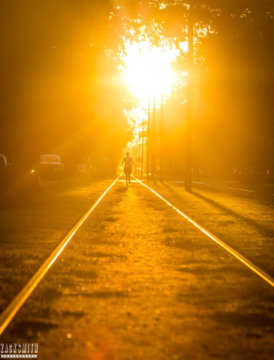 jogger-sunrise-streetcar-tracks-st-charles-avenue-zack-smith-photography-new-orleans-photographer