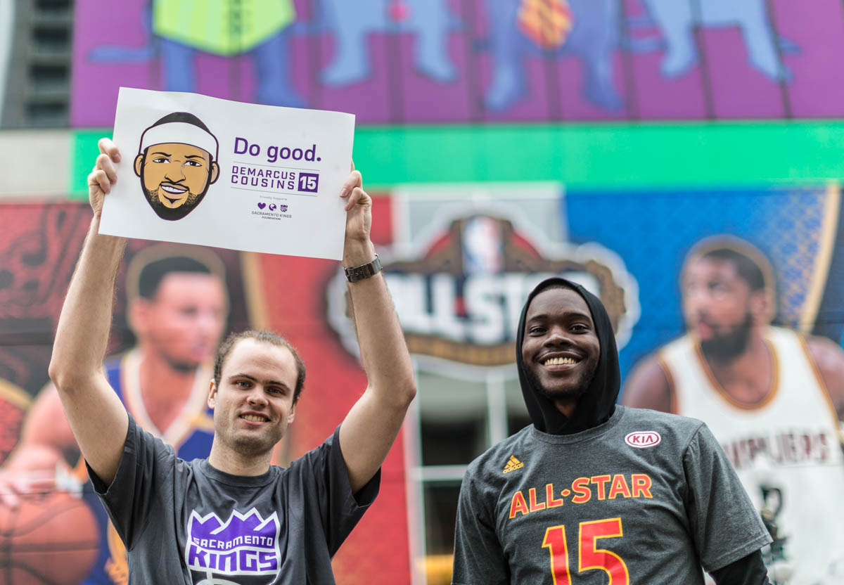 Nick and David model some Kings gear in front of the Sheraton's huge NBA wrap on Canal St.
