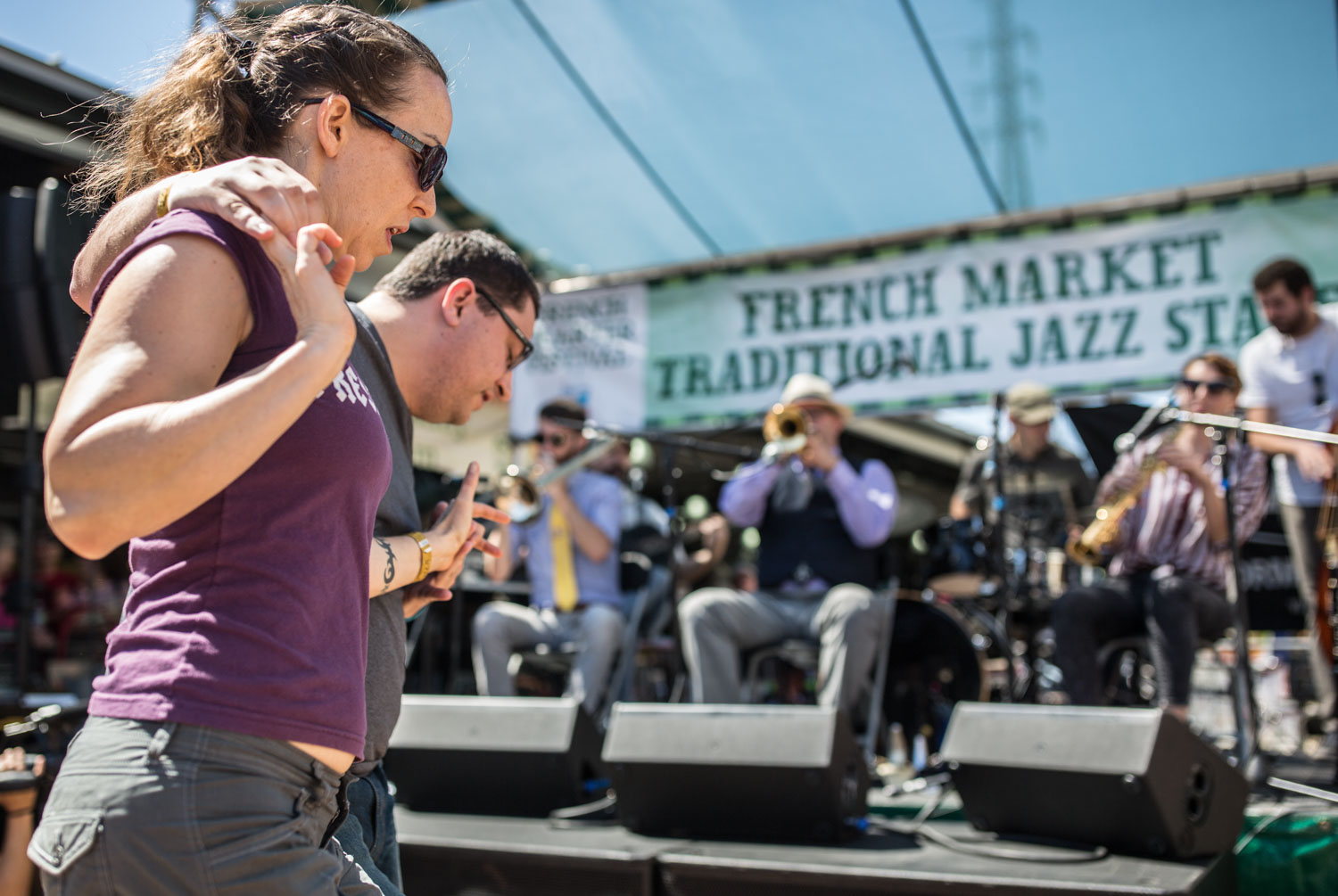 A swing dancing couple enjoy the sounds of Aurora Nealand's band at the French Market Stage.