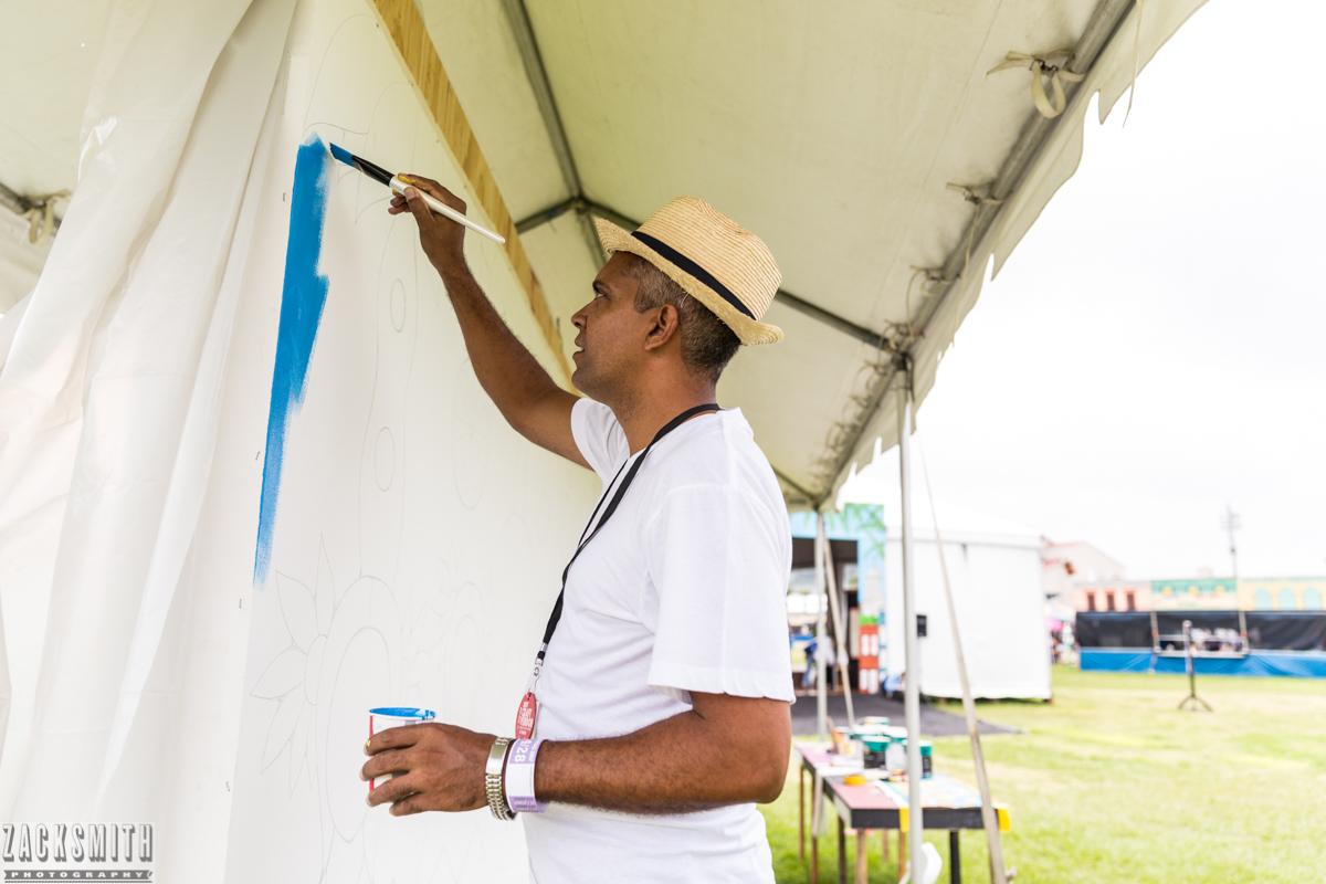 Muralist Roberto Guerra Hechaverria painting at Jazz Fest 2017.