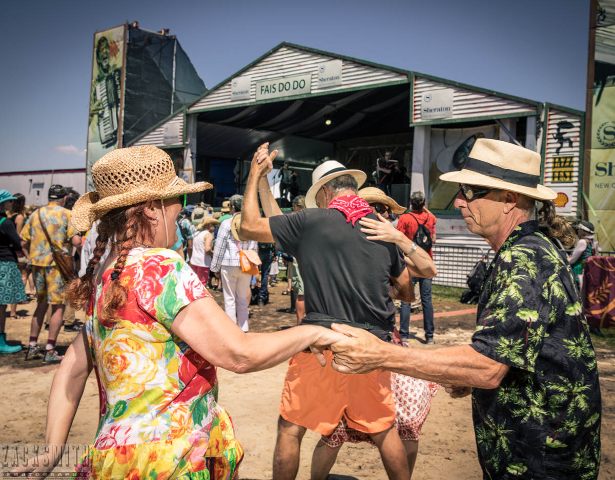 Dancers do their thing, all day long, at the Fais Do Do stage at Jazz Fest.