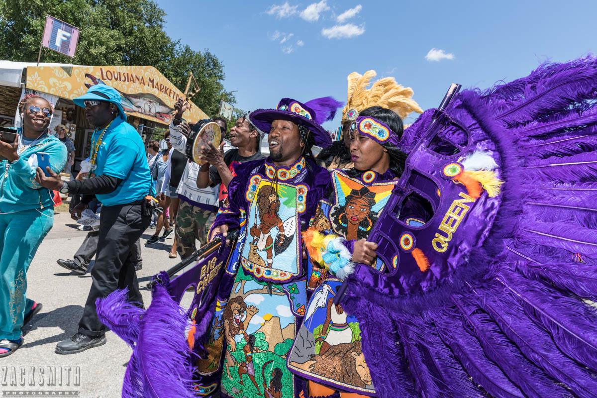 Big Chief Juan Pardo and Big Queen Anndrea Y. Pardo of the Golden Comanches march on Jazz Fest
