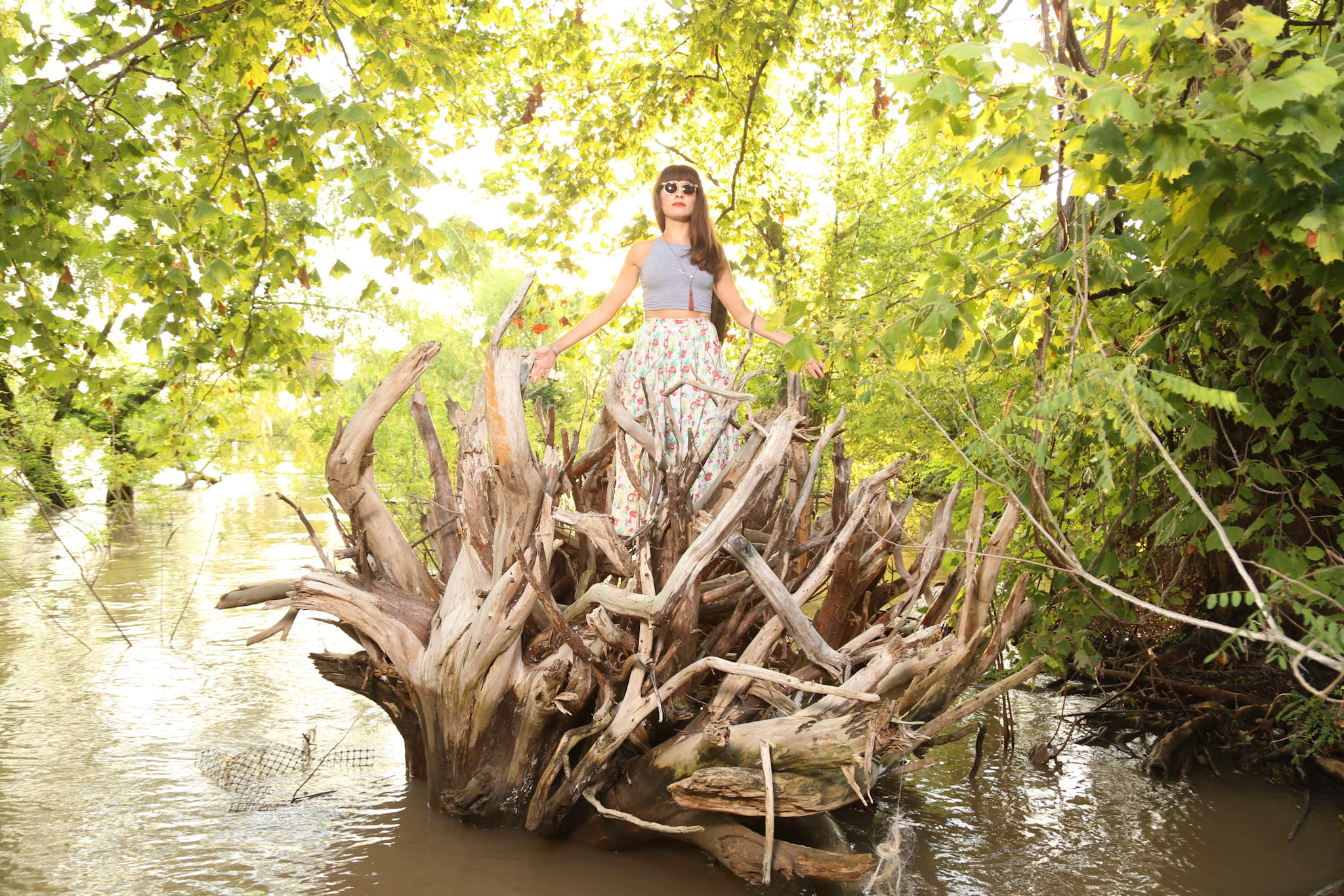 Amanda Helm rides ashore a Mississippi River tree. ©Zack Smith 2012