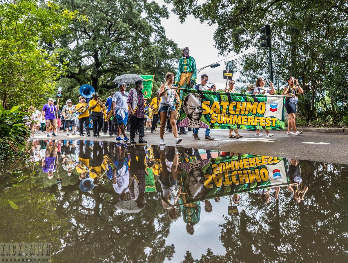 Satchmo Summerfest rolls despite the standing water and soggy shoes.