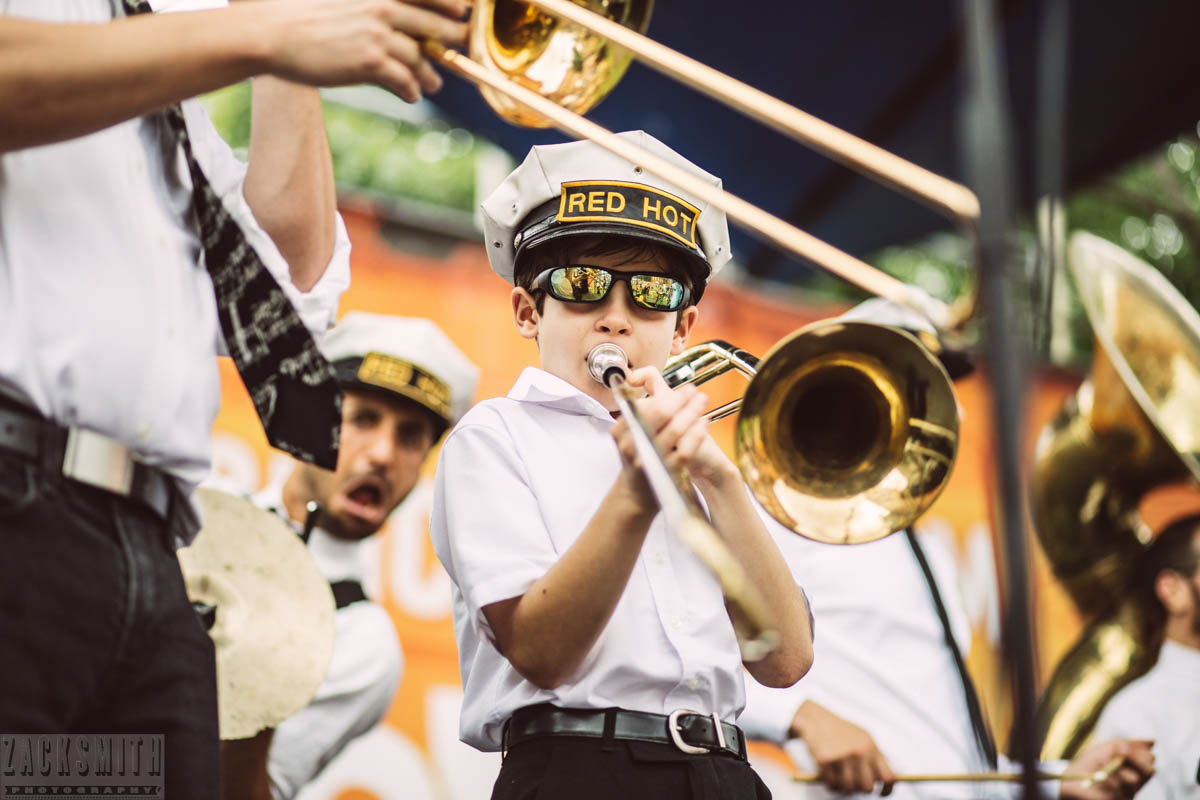 """John """"Spidey 504"""" Sanpietro performs with the Red Hot Brass Band at French Quarter Fest 2018."""