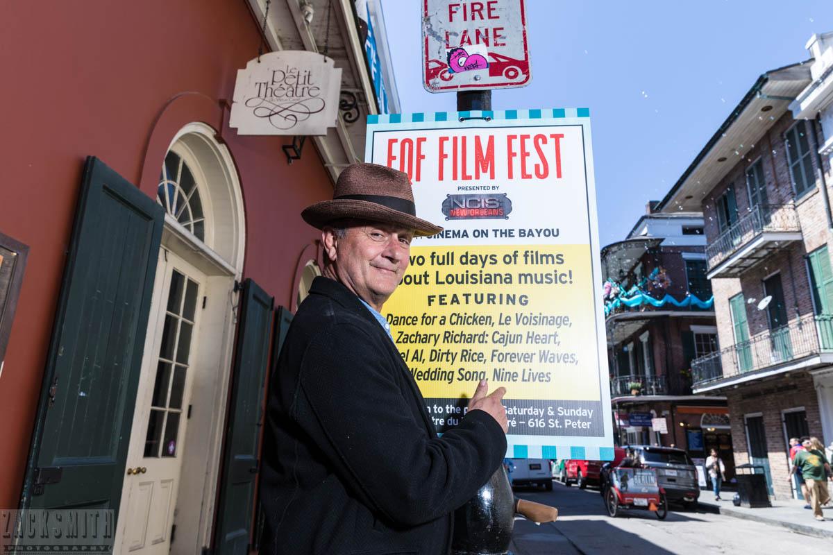 Paul Sanchez poses with the Film Fest poster promoting his film; Nine Lives.