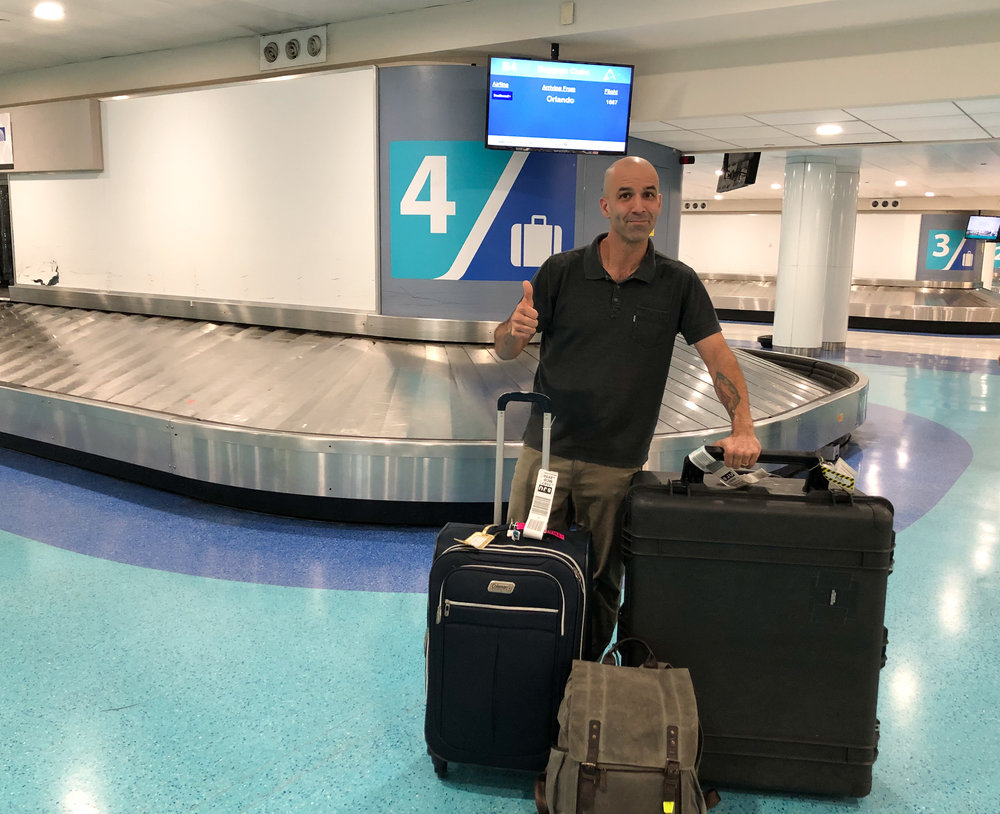 Here I am at the San Juan airport with my entire photo studio, cameras, and clothes!