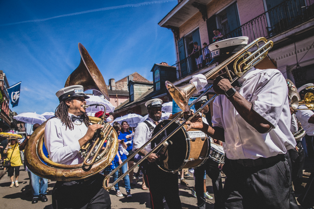The Kinfolk Brass Band led the opening day Second Line to start the 36th Annual French Quarter Fest. ©Zack Smith Photography