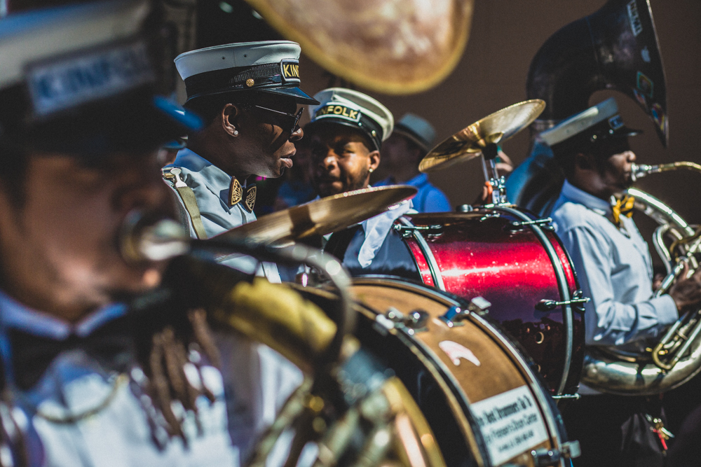 The low rising sun can be troublesome shooting down the blocks of Bourbon Street. Though it's nice to find it bouncing off fresh polished cymbals and horns. ©Zack Smith Photography