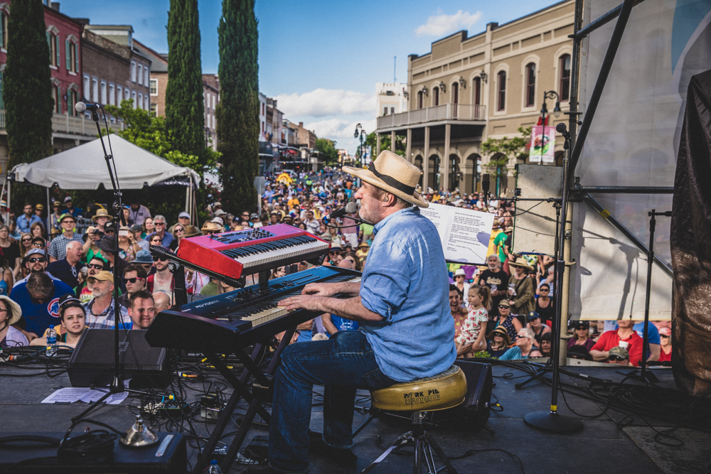 Jon Cleary plays to a packed French Quarter as he closes out Day One at the Chevron Stage. ©Zack Smith Photography