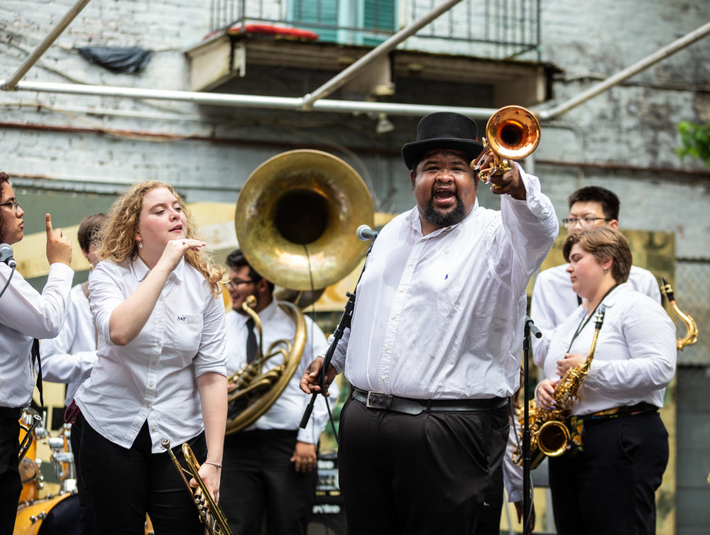 Trumpeter and bandleader Desmond Venable lead students and fire up the crowd. ©Zack Smith Photography